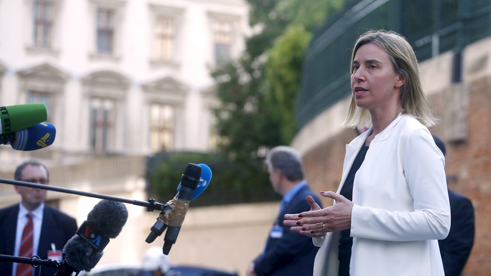 European Union foreign policy chief Federica Mogherini talks to reporters outside the Palais Coburg hotel where the Iran nuclear talks meetings are being held in Vienna, Austria June 28, 2015. The six nations seeking to negotiate a long-term agreement with Iran to curb the most sensitive parts of its nuclear programme plan to continue negotiating beyond Tuesday's deadline, a senior U.S. official said. REUTERS/Carlos Barria - RTX1I5IX
