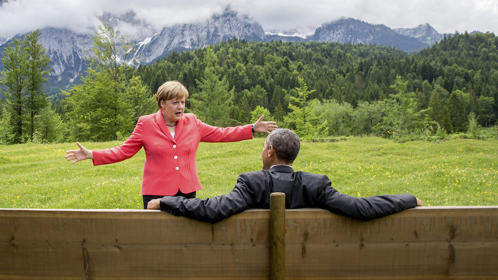 German Chancellor Angela Merkel speaks with U.S. President Barack Obama outside the Elmau castle in Kruen near Garmisch-Partenkirchen, Germany, June 8, 2015. Leaders of the Group of Seven (G7) industrial nations vowed at a summit in the Bavarian Alps on Sunday to keep sanctions against Russia in place until President Vladimir Putin and Moscow-backed separatists fully implement the terms of a peace deal for Ukraine. REUTERS/Michael Kappeler/Pool TPX IMAGES OF THE DAY - RTX1FMFF