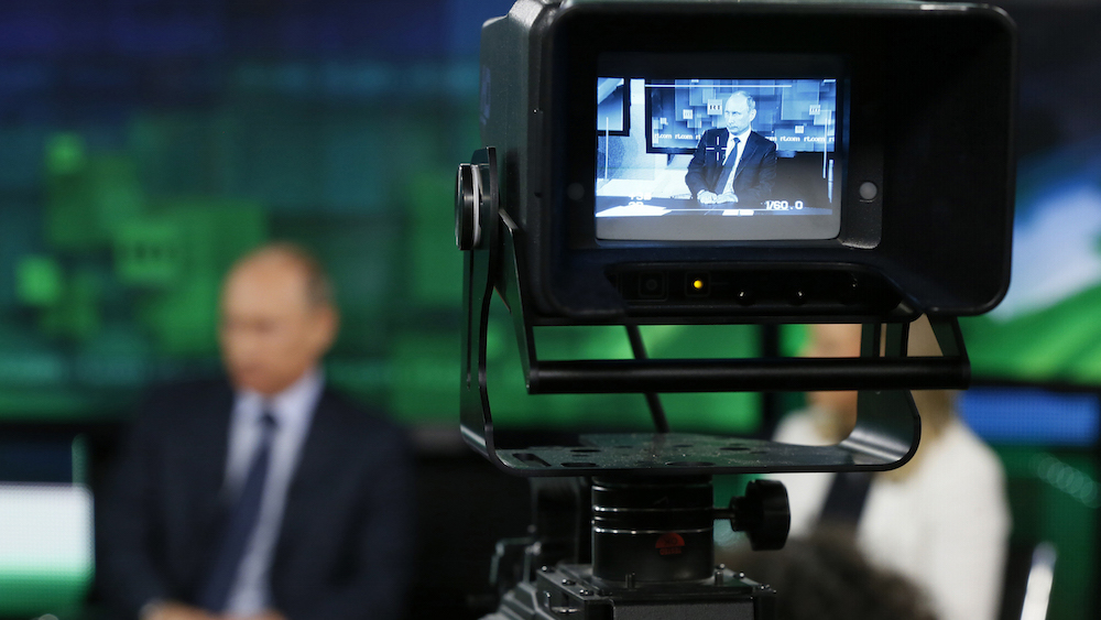 Russian President Vladimir Putin is seen on the screen of a television camera during his visit to the new studio complex of television channel 'Russia Today' in Moscow June 11, 2013. Russian President Vladimir Putin said on Tuesday he has no doubt that Iran is adhering to international commitments on nuclear non-proliferation but regional and international concerns about Tehran's nuclear programme could not be ignored. REUTERS/Yuri Kochetkov/Pool (RUSSIA - Tags: POLITICS) - RTX10K2Q