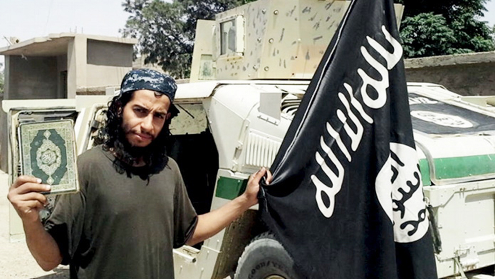 "An undated photograph of a man described as Abdelhamid Abaaoud that was published in the Islamic State's online magazine Dabiq and posted on a social media website. A Belgian national currently in Syria and believed to be one of Islamic State's most active operators is suspected of being behind Friday's attacks in Paris, acccording to a source close to the French investigation. ""He appears to be the brains behind several planned attacks in Europe,"" the source told Reuters of Abdelhamid Abaaoud, adding he was investigators' best lead as the person likely behind the killing of at least 129 people in Paris on Friday. According to RTL Radio, Abaaoud is a 27-year-old from the Molenbeek suburb of Brussels, home to other members of the militant Islamist cell suspected of having carried out the attacks. REUTERS/Social Media Website via Reuters TVATTENTION EDITORS - THIS PICTURE WAS PROVIDED BY A THIRD PARTY. REUTERS IS UNABLE TO INDEPENDENTLY VERIFY THE AUTHENTICITY, CONTENT, LOCATION OR DATE OF THIS IMAGE. FOR EDITORIAL USE ONLY. NOT FOR SALE FOR MARKETING OR ADVERTISING CAMPAIGNS. FOR EDITORIAL USE ONLY. THIS PICTURE WAS PROCESSED BY REUTERS TO ENHANCE QUALITY. - RTS7CLF"