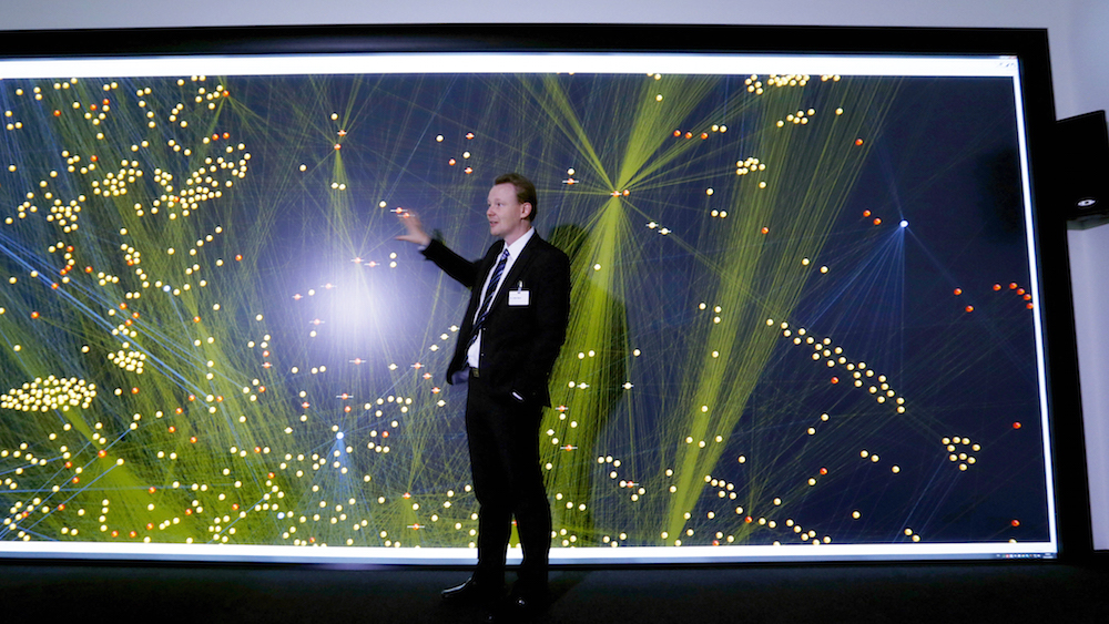 Employee Lothar Baum explains how a 'Data Mining' 12 million pixel wide screen works before the BOSCH's official opening ceremony of the company's new center for research and advance engineering Campus Renningen in Renningen, Germany, October 14, 2015. REUTERS/Michaela Rehle - RTS4ESW