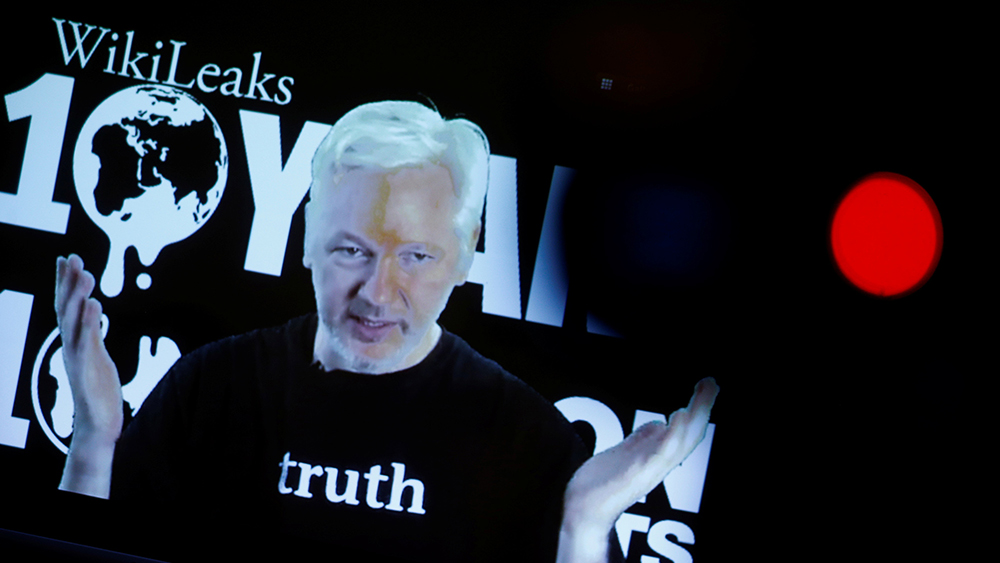 Julian Assange, Founder and Editor-in-Chief of WikiLeaks speaks via video link during a press conference on the occasion of the ten year anniversary celebration of WikiLeaks in Berlin, Germany, October 4, 2016. REUTERS/Axel Schmidt - RTSQNLY