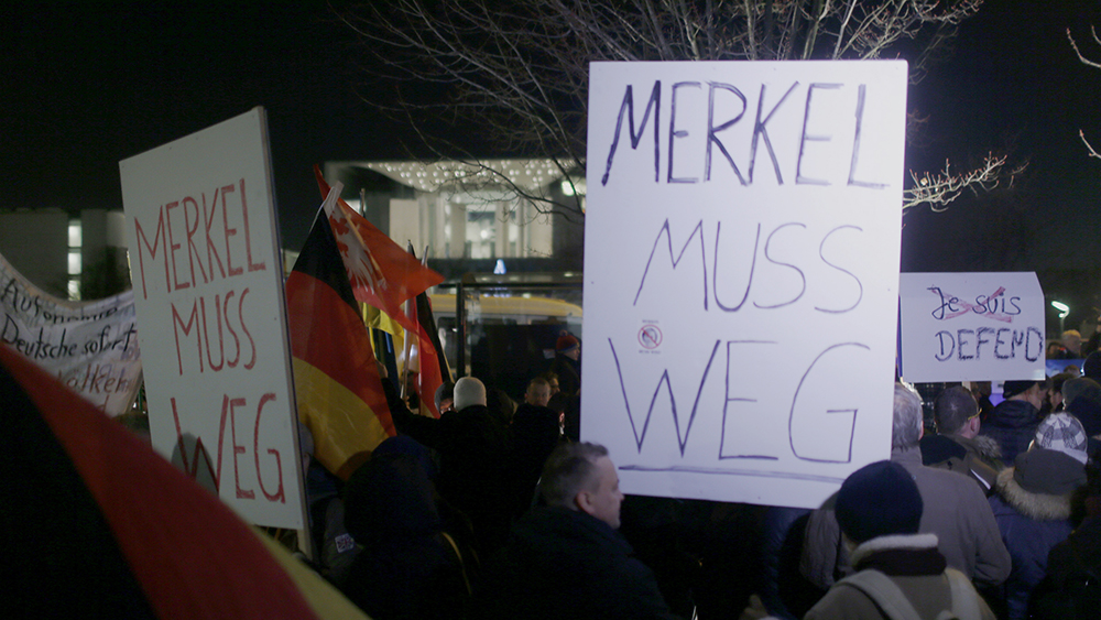 "Anti-immigration party Alternative for Germany (AfD) supporters hold placards reading""Merkel must go"" to demonstrate against German Chancellor Angela Merkel's migrant policy in front of the chancellery in Berlin, Germany, December 21, 2016, after a truck ploughed through a crowd at a Christmas market in the captial on Monday night. REUTERS/Hannibal Hanschke - RTX2W1ZW"