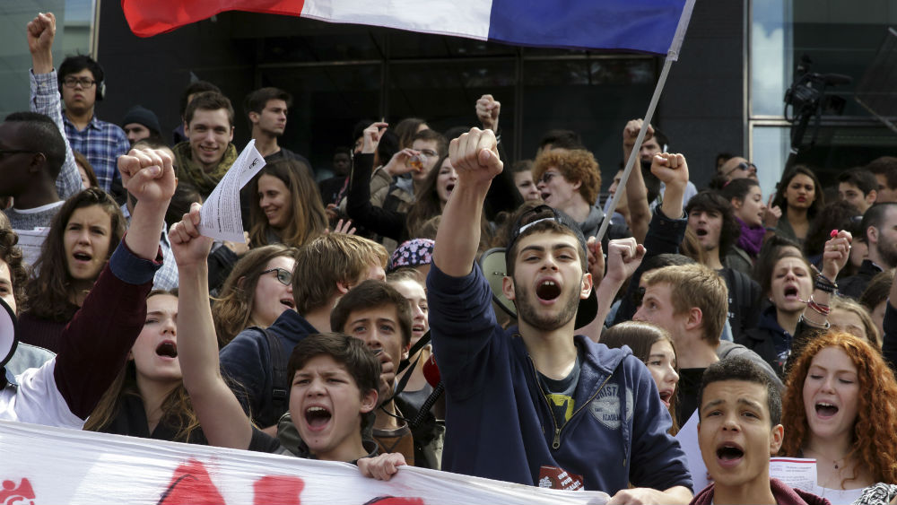 French students demonstrate against the results by France's far-right National Front political party in the 2014 European election in Paris